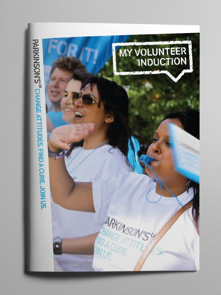 Volunteers cheering on cover of Parkinson's UK Volunteer Induction manual.