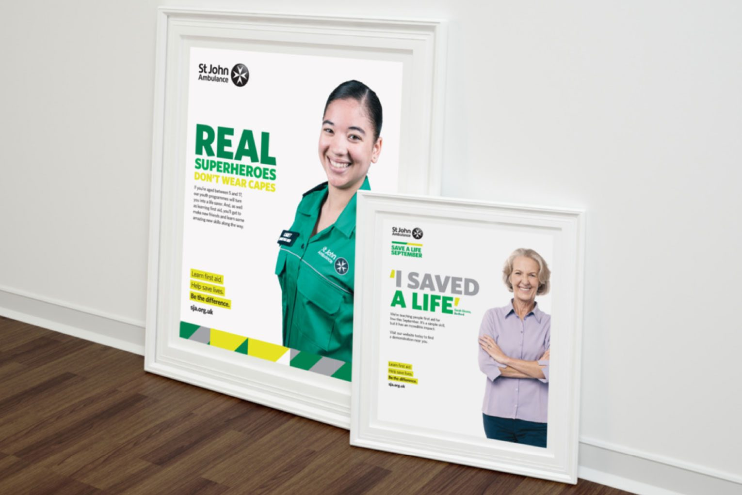 Branded posters featuring St John Ambulance volunteers.
