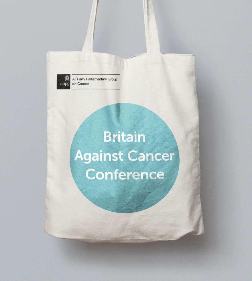 Britain Against Cancer white canvas bag with new brand teal logo.