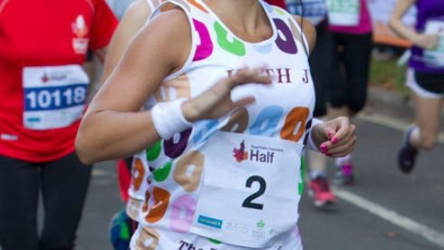 Challenge events proposition, runner at an event wearing a branded Challenge event running vest.