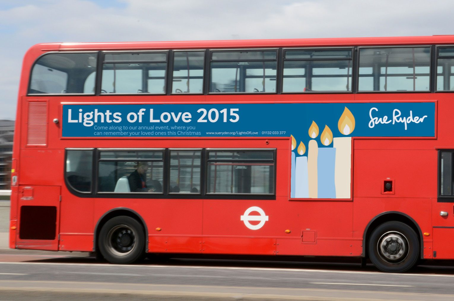Lights of love services advertised on a red bus.