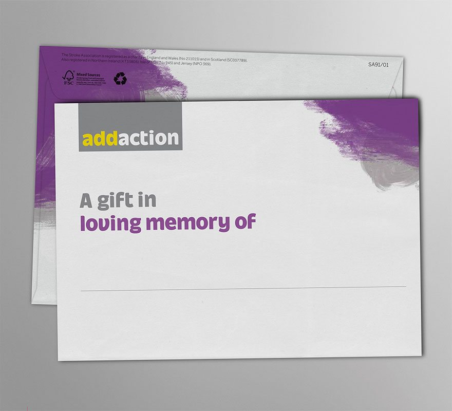 New fundraising visual identity applied to In Mem envelope using purple and grey swirls.