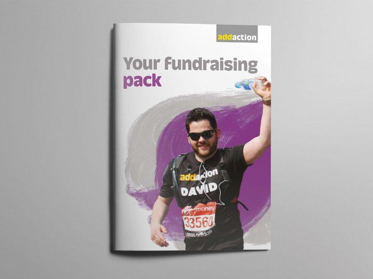New fundraising visual identity applied to the front of the event pack.