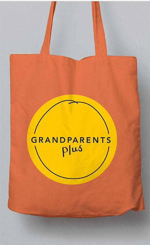 Orange tote bag with Grandparents Plus logo.