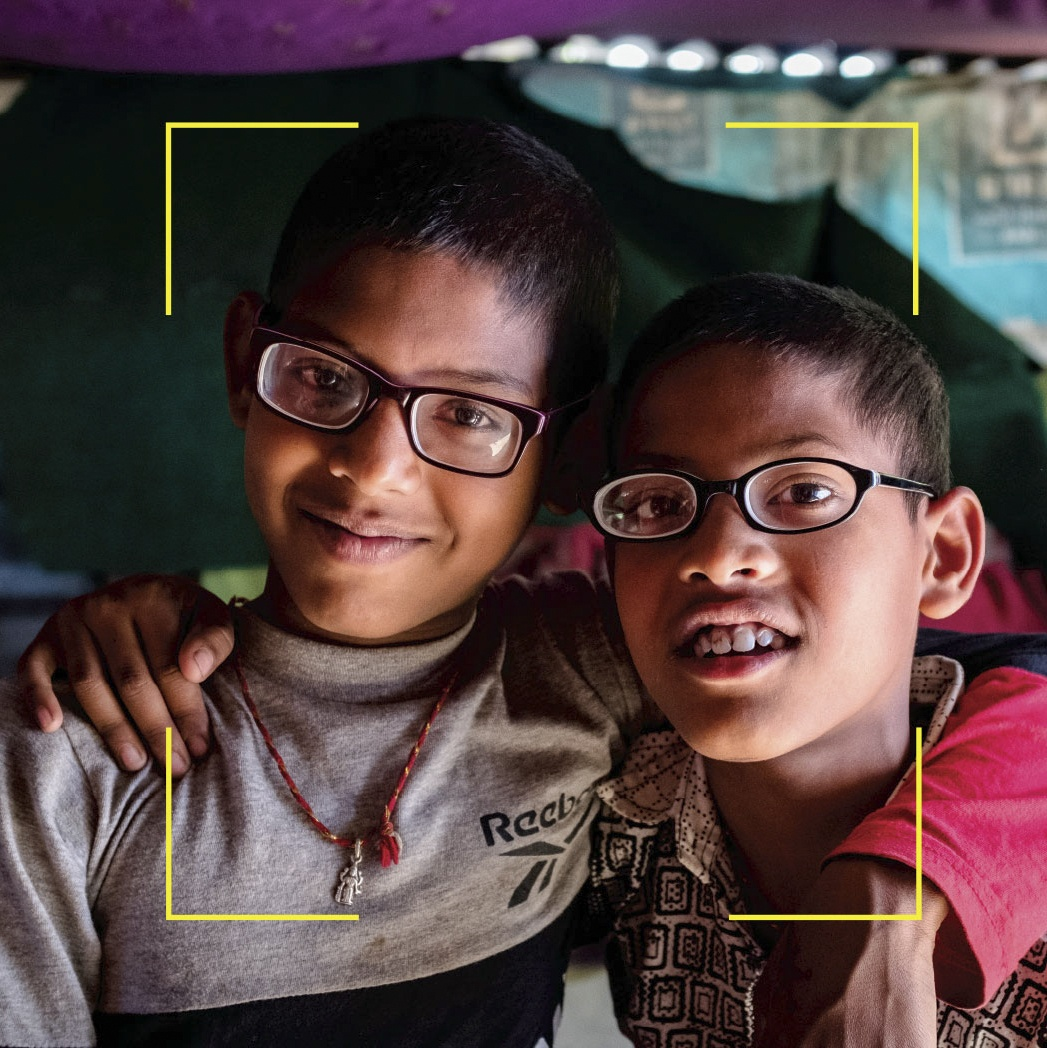 Two children Orbis provided glasses for in Nepal