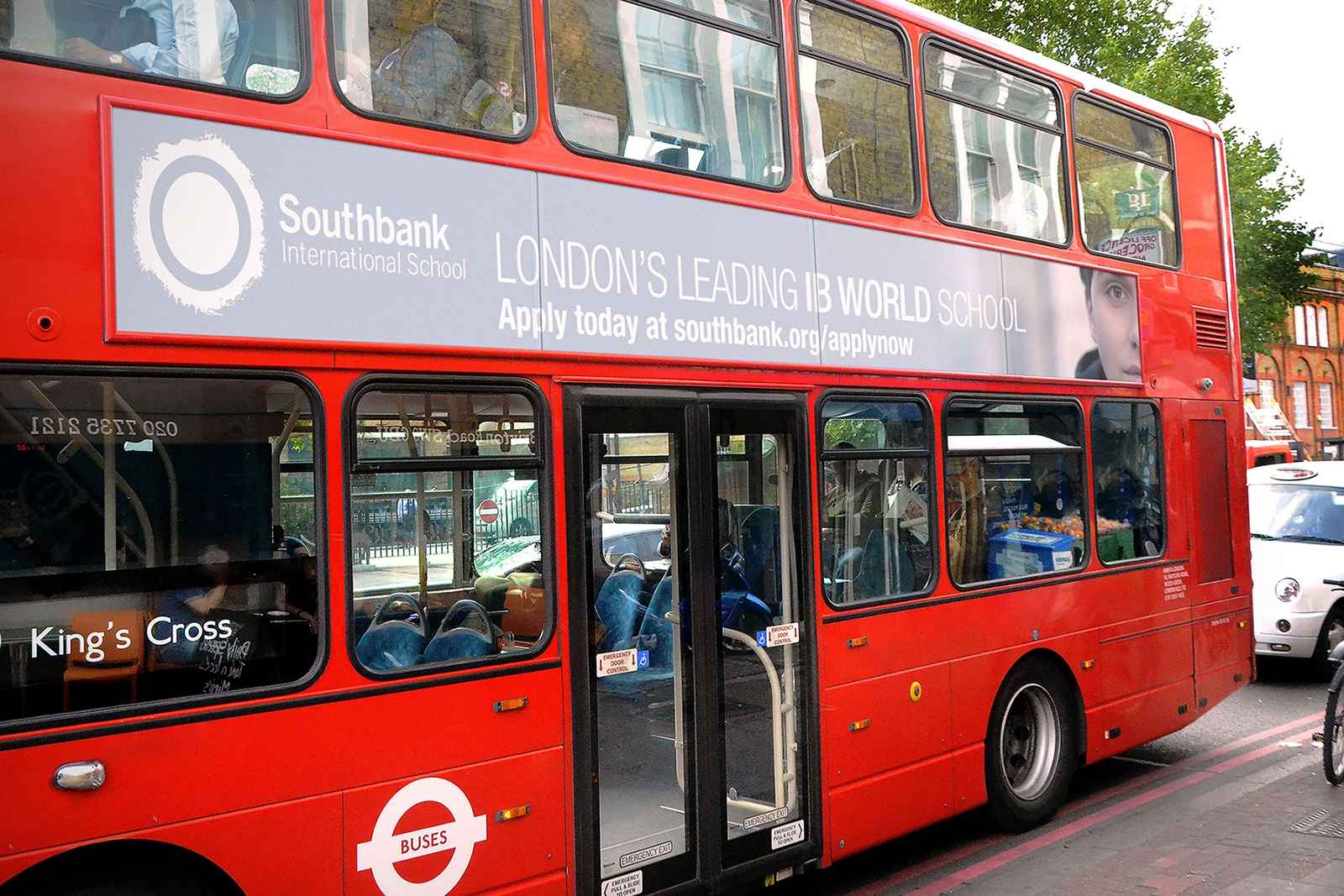 Image of the campaign identity on the side of a London bus