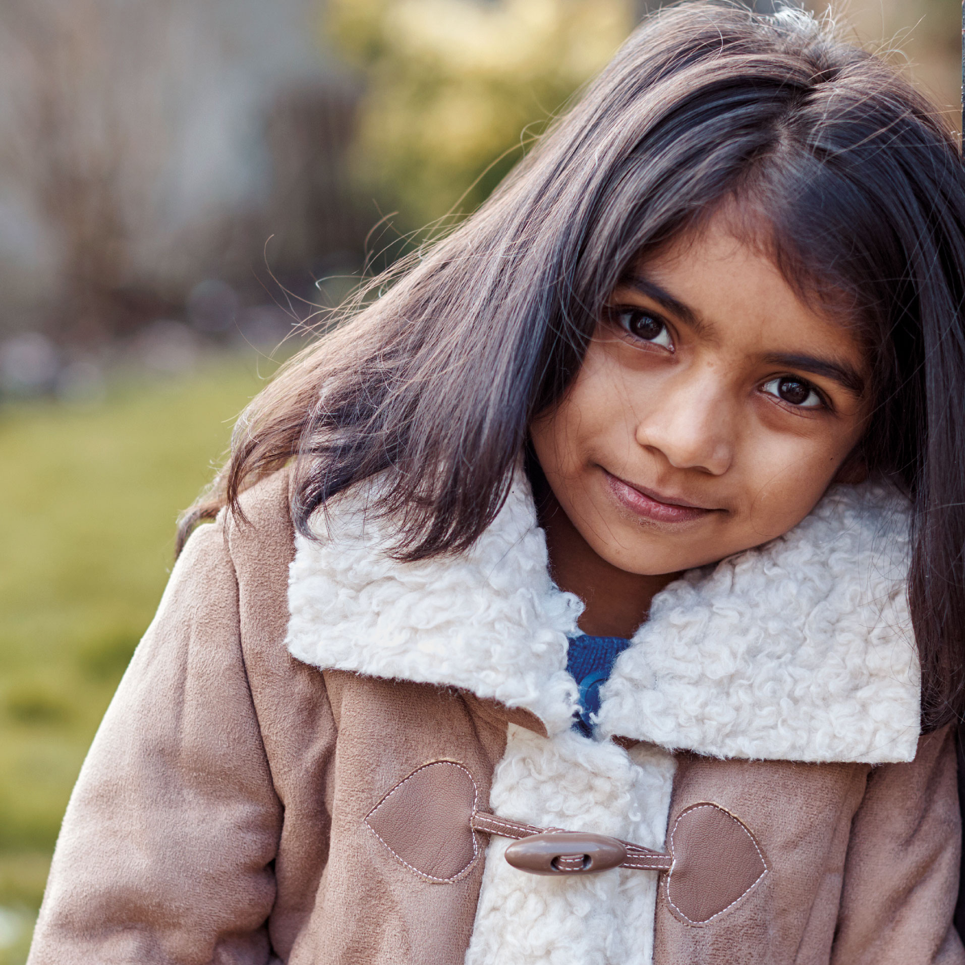 Image of little girl from the pack. Looking directly at camera.